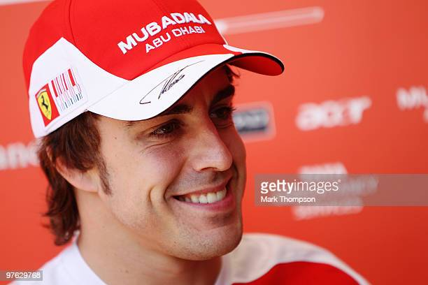 Fernando Alonso of Spain and Ferrari is interviewed in the paddock during previews to the Bahrain Formula One Grand Prix at the Bahrain International...