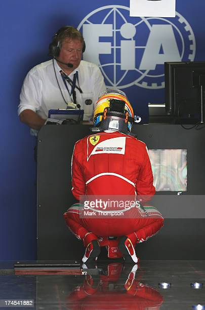 Fernando Alonso of Spain and Ferrari is seen in the official weighing area following qualifying for the Hungarian Formula One Grand Prix at...