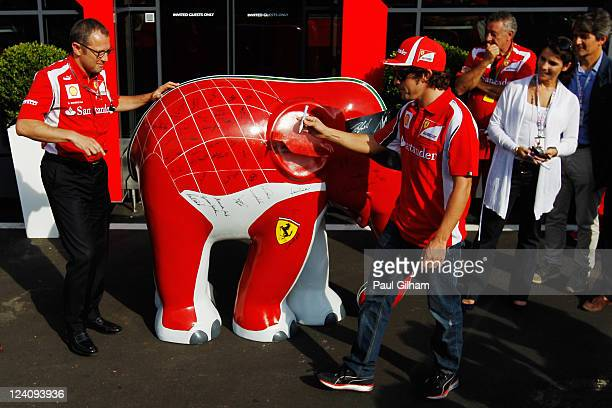 Fernando Alonso of Spain and Ferrari is seen in the paddock during previews to the Italian Formula One Grand Prix at the Autodromo Nazionale di Monza...