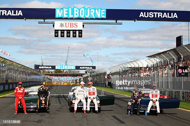 Fernando Alonso of Spain and Ferrari, Kimi Raikkonen of Finland and Lotus, Michael Schumacher of Germany and Mercedes GP, Jenson Button of Great...