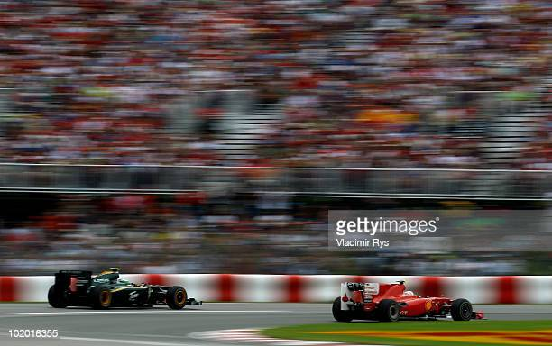 Fernando Alonso of Spain and Ferrari leads from Heikki Kovalainen of Finland and Lotus during qualifying for the Canadian Formula One Grand Prix at...