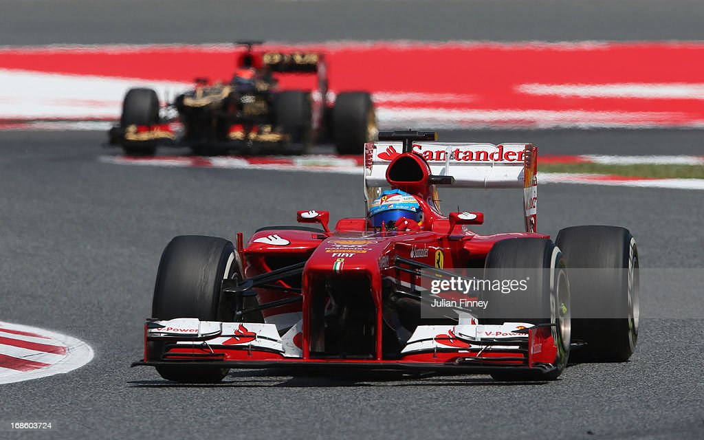 Fernando Alonso of Spain and Ferrari leads from Kimi Raikkonen of Finland and Lotus on his way to winning the Spanish Formula One Grand Prix at the Circuit de Catalunya on May 12, 2013 in Montmelo, Spain.