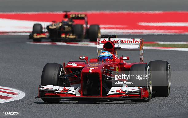 Fernando Alonso of Spain and Ferrari leads from Kimi Raikkonen of Finland and Lotus on his way to winning the Spanish Formula One Grand Prix at the...