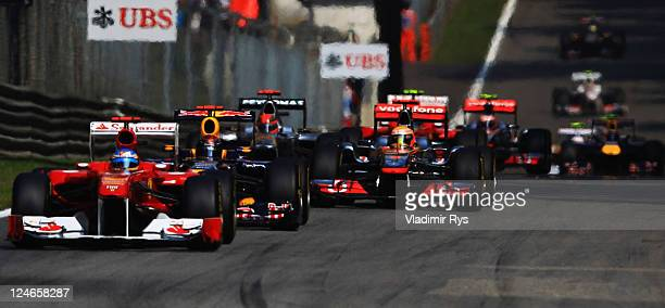 Fernando Alonso of Spain and Ferrari leads from Sebastian Vettel of Germany and Red Bull Racing and Lewis Hamilton of Great Britain and McLaren at...