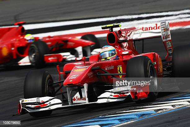 Fernando Alonso of Spain and Ferrari leads from team mate Felipe Massa of Brazil and Ferrari after overtaking him during the German Grand Prix at...