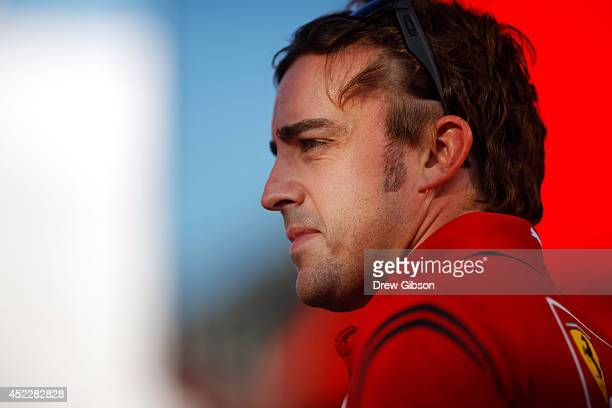 Fernando Alonso of Spain and Ferrari looks on in the paddock during previews ahead of the German Grand Prix at Hockenheimring on July 17 2014 in...