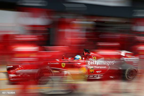 Fernando Alonso of Spain and Ferrari makes a pit stop during the British Formula One Grand Prix at Silverstone Circuit on July 6 2014 in Northampton...