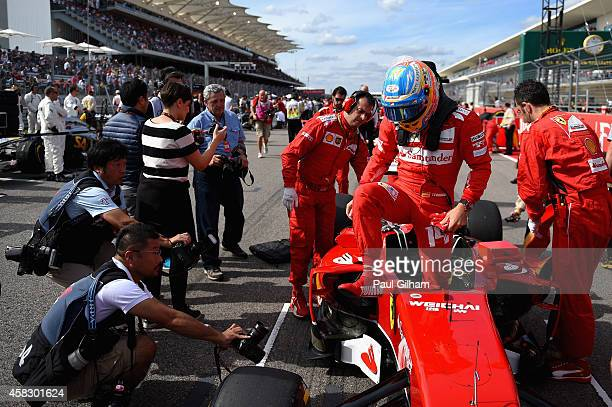 Fernando Alonso of Spain and Ferrari prepares on the grid before the United States Formula One Grand Prix at Circuit of The Americas on November 2...