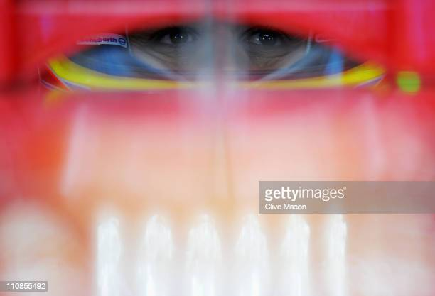Fernando Alonso of Spain and Ferrari prepares to drive during practice for the Australian Formula One Grand Prix at the Albert Park Circuit on March...