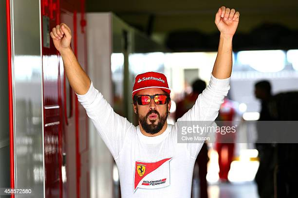 Fernando Alonso of Spain and Ferrari reacts next to the garage during practice ahead of the Brazilian Formula One Grand Prix at Autodromo Jose Carlos...