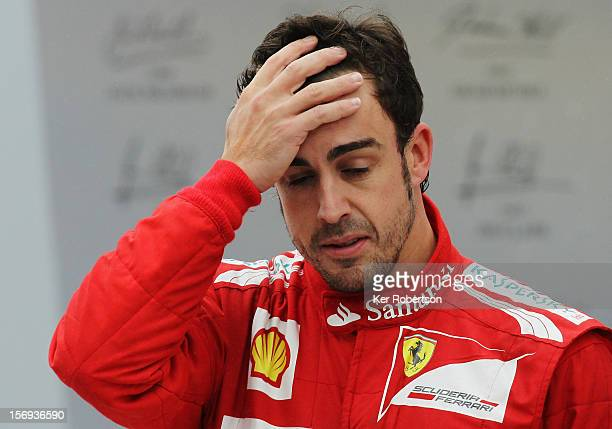 Fernando Alonso of Spain and Ferrari reacts on the podium after finishing second in the race and second in the drivers world championship following...