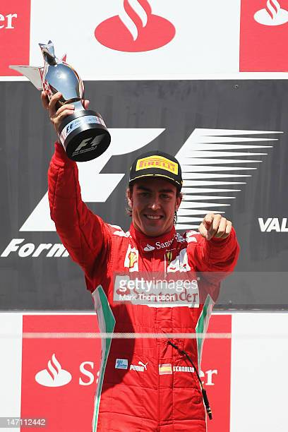Fernando Alonso of Spain and Ferrari reacts on the podium after winning the European Grand Prix at the Valencia Street Circuit on June 24, 2012 in...