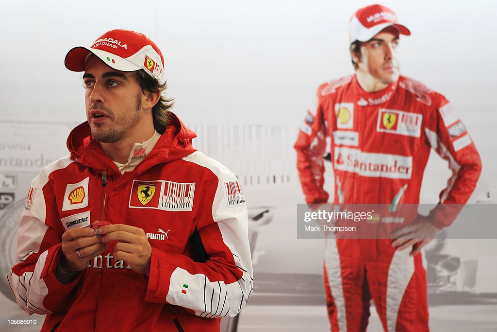 Fernando Alonso of Spain and Ferrari sits in his team garage as torrential rain causes the postponement of qualifying for the Japanese Formula One Grand Prix at Suzuka Circuit on October 9, 2010 in Suzuka, Japan.