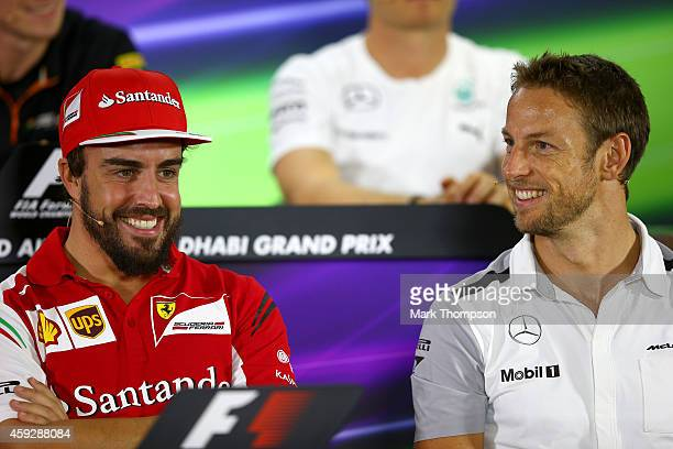 Fernando Alonso of Spain and Ferrari smiles with Jenson Button of Great Britain and McLaren during the drivers' press conference during previews...