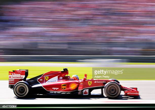 Fernando Alonso of Spain and Ferrari waves to the fans folowing Qualifying ahead of the F1 Grand Prix of Italy at Autodromo di Monza on September 6...