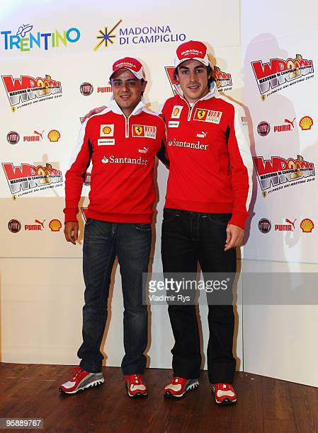 Fernando Alonso of Spain and his team mate Felipe Massa of Brazil and Ferrari pose for a photo at a press conference during the Wroom 2010 on January...