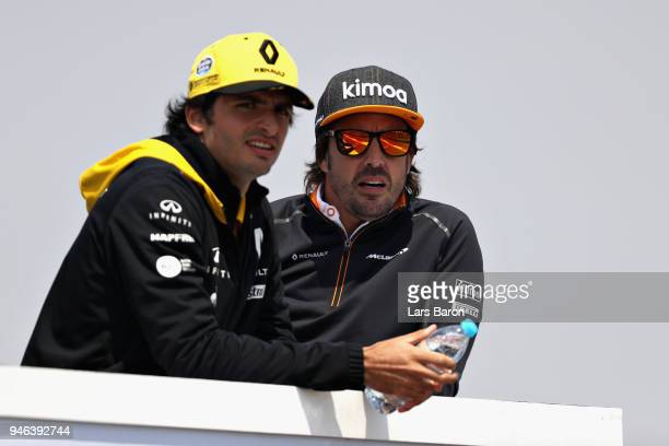 Fernando Alonso of Spain and McLaren F1 and Carlos Sainz of Spain and Renault Sport F1 talk on the drivers parade before the Formula One Grand Prix...