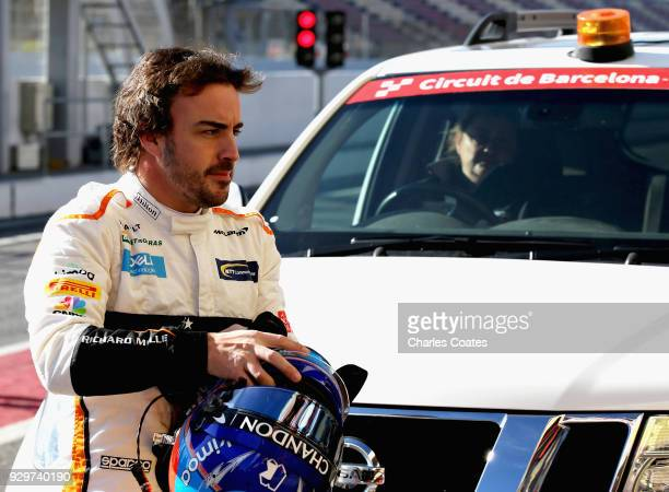 Fernando Alonso of Spain and McLaren F1 is returned to the pitlane after stopping on track during day four of F1 Winter Testing at Circuit de...
