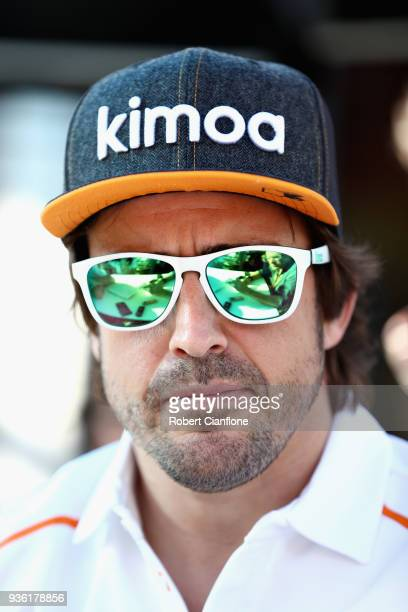 Fernando Alonso of Spain and McLaren F1 looks on in the Paddock during previews ahead of the Australian Formula One Grand Prix at Albert Park on...
