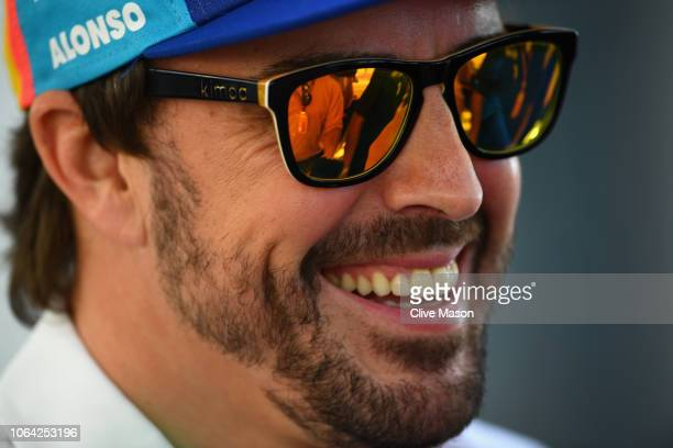 Fernando Alonso of Spain and McLaren F1 talks to the media in the Paddock during previews ahead of the Abu Dhabi Formula One Grand Prix at Yas Marina...