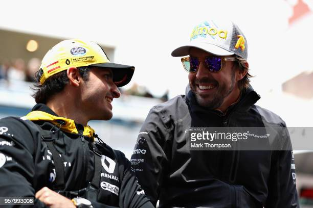 Fernando Alonso of Spain and McLaren F1 talks with Carlos Sainz of Spain and Renault Sport F1 on the drivers parade before the Spanish Formula One...