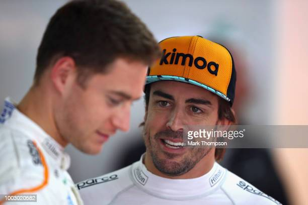 Fernando Alonso of Spain and McLaren F1 talks with Stoffel Vandoorne of Belgium and McLaren F1 in the garage during final practice for the Formula...