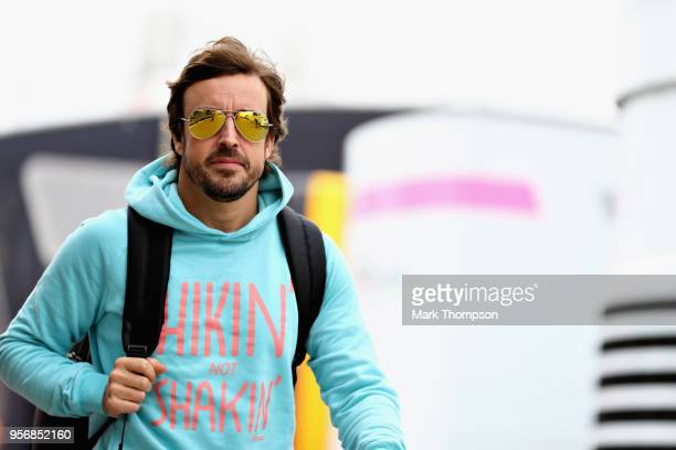 Fernando Alonso of Spain and McLaren F1 walks in the Paddock during previews ahead of the Spanish Formula One Grand Prix at Circuit de Catalunya on...