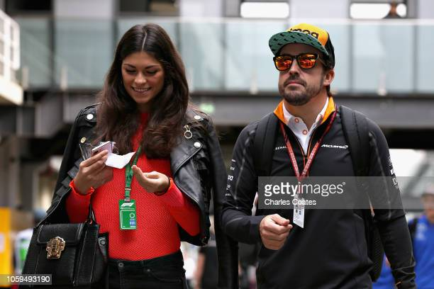 Fernando Alonso of Spain and McLaren F1 walks in the Paddock with girlfriend Linda Morselli before practice for the Formula One Grand Prix of Brazil...