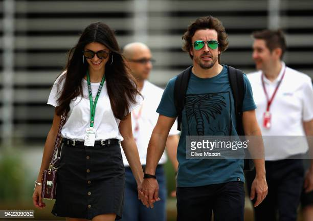Fernando Alonso of Spain and McLaren F1 walks in the Paddock with girlfriend Linda Morselli during previews ahead of the Bahrain Formula One Grand...