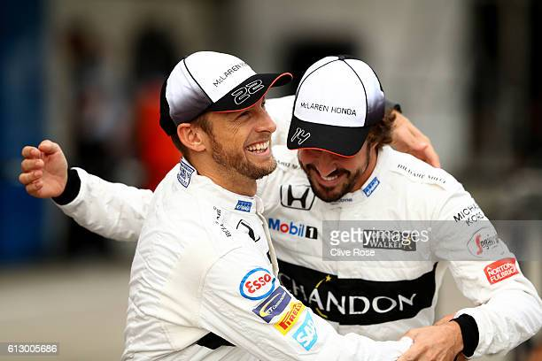 Fernando Alonso of Spain and McLaren Honda and Jenson Button of Great Britain and McLaren Honda joke around at the McLaren Honda team photo during...
