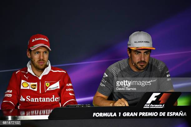 Fernando Alonso of Spain and McLaren Honda and Sebastian Vettel of Germany and Ferrari in the Drivers Press Conference during previews for the...