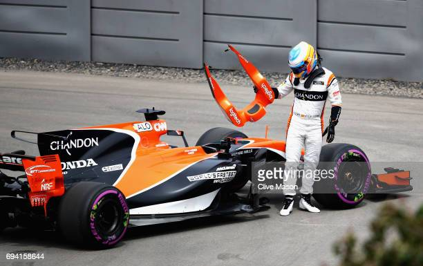 Fernando Alonso of Spain and McLaren Honda climbs out of his car after stopping on track during practice for the Canadian Formula One Grand Prix at...