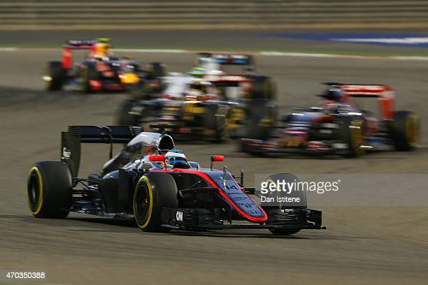Fernando Alonso of Spain and McLaren Honda drives during the Bahrain Formula One Grand Prix at Bahrain International Circuit on April 19 2015 in...