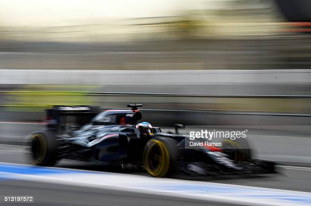 Fernando Alonso of Spain and McLaren Honda drives in the pit lane during day one of F1 winter testing at Circuit de Catalunya on March 1 2016 in...