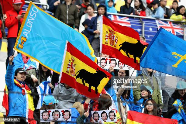 Fernando Alonso of Spain and McLaren Honda fans in the grandstand during the Formula One Grand Prix of China at Shanghai International Circuit on...