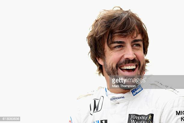 Fernando Alonso of Spain and McLaren Honda laughs at the McLaren Honda team photo during practice for the Formula One Grand Prix of Japan at Suzuka...