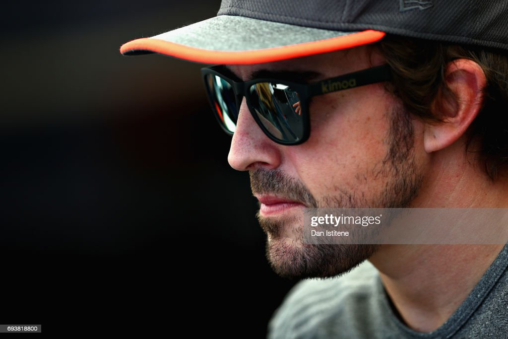 Fernando Alonso of Spain and McLaren Honda looks on in the Paddock during previews for the Canadian Formula One Grand Prix at Circuit Gilles Villeneuve on June 8, 2017 in Montreal, Canada.