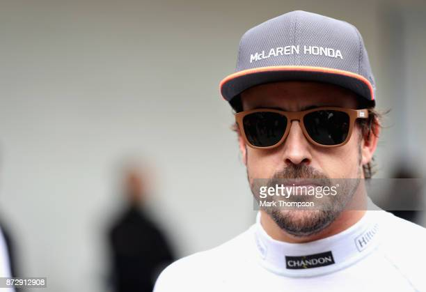Fernando Alonso of Spain and McLaren Honda looks on in the Paddock after qualifying for the Formula One Grand Prix of Brazil at Autodromo Jose Carlos...