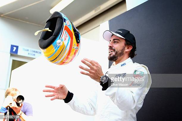 Fernando Alonso of Spain and McLaren Honda poses for photographers outside the team garage during previews to the Malaysia Formula One Grand Prix at...