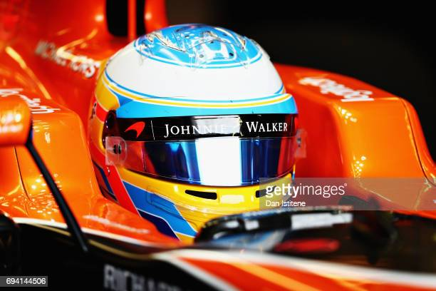 Fernando Alonso of Spain and McLaren Honda prepares to drive in the garage during practice for the Canadian Formula One Grand Prix at Circuit Gilles...