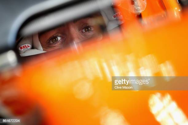 Fernando Alonso of Spain and McLaren Honda prepares to drive in the garage during final practice for the United States Formula One Grand Prix at...