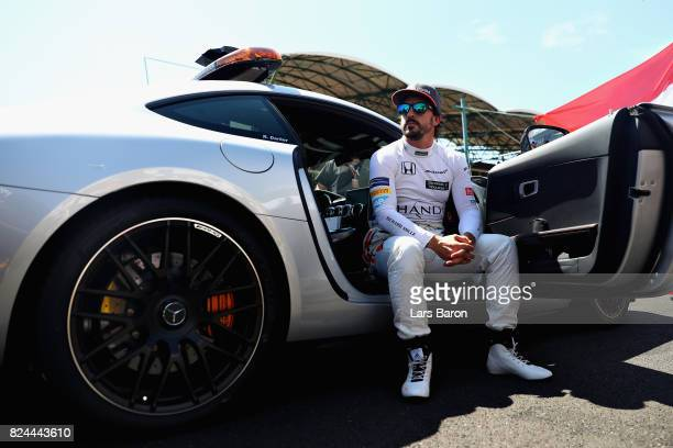 Fernando Alonso of Spain and McLaren Honda prepares to drive on the grid before the Formula One Grand Prix of Hungary at Hungaroring on July 30 2017...