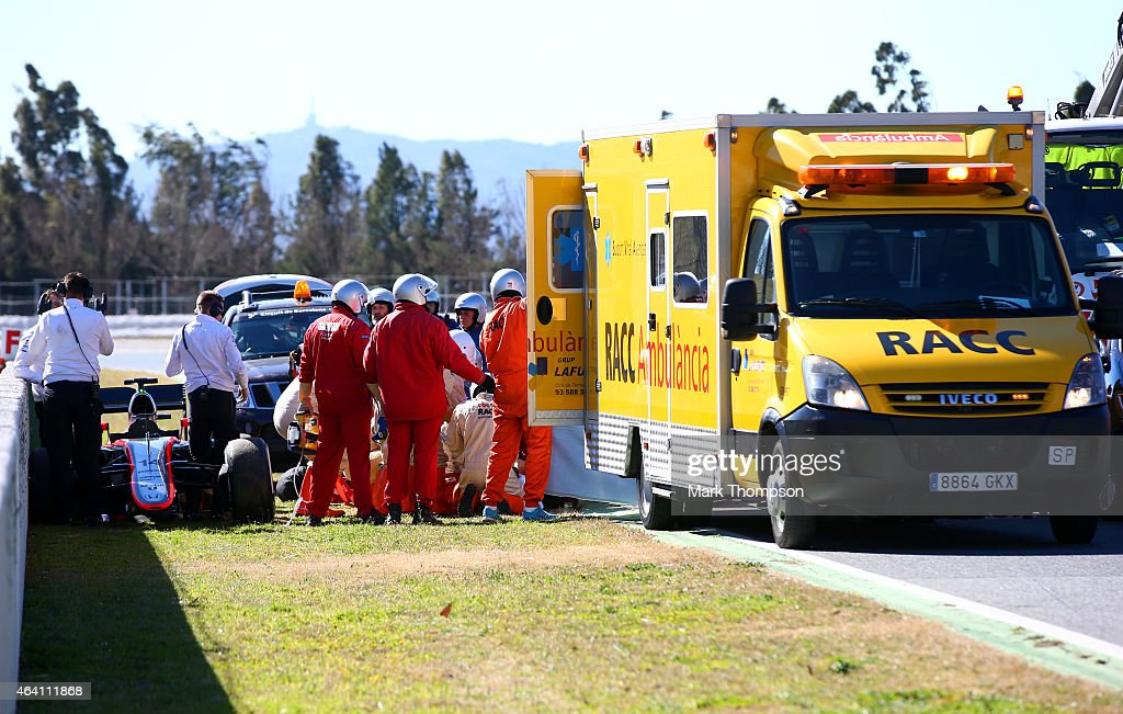 Fernando Alonso of Spain and McLaren Honda receives medical assistance after crashing during day four of Formula One Winter Testing at Circuit de Catalunya on February 22, 2015 in Montmelo, Spain.