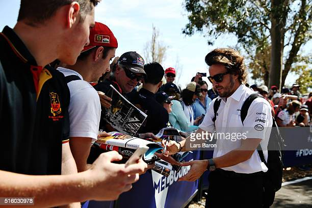 Fernando Alonso of Spain and McLaren Honda signs autographs for fans during previews to the Australian Formula One Grand Prix at Albert Park on March...