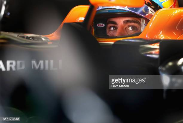 Fernando Alonso of Spain and McLaren Honda sits in his car in the garage during practice for the Australian Formula One Grand Prix at Albert Park on...