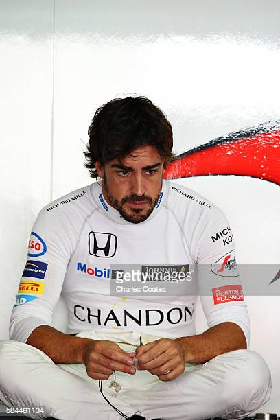 Fernando Alonso of Spain and McLaren Honda sits in the back of the garage during practice for the Formula One Grand Prix of Germany at Hockenheimring...