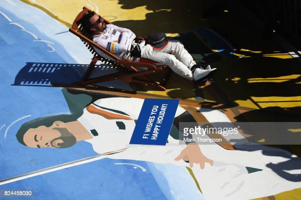 Fernando Alonso of Spain and McLaren Honda takes a seat in parc ferme during the Formula One Grand Prix of Hungary at Hungaroring on July 30 2017 in...