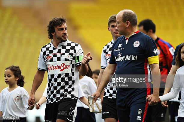 Fernando Alonso of Spain and McLaren Honda talks to Prince Albert of Monaco ahead of the 24th World Stars football match at Stade Louis II Monaco...