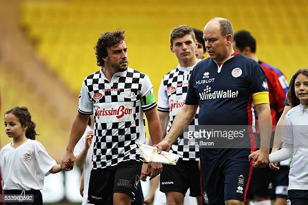 Fernando Alonso of Spain and McLaren Honda talks to Prince Albert of Monaco ahead of the 24th World Stars football match at Stade Louis II Monaco...