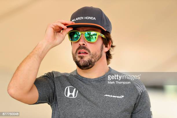 Fernando Alonso of Spain and McLaren Honda walks in the Paddock during previews for the Abu Dhabi Formula One Grand Prix at Yas Marina Circuit on...